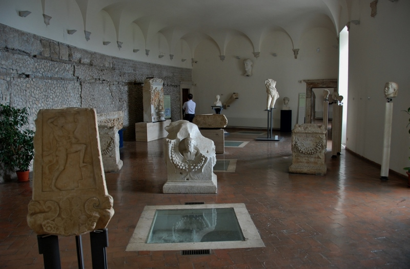 "One of the museum rooms with floor ""archaeological windows""  showing roman column pedestals"