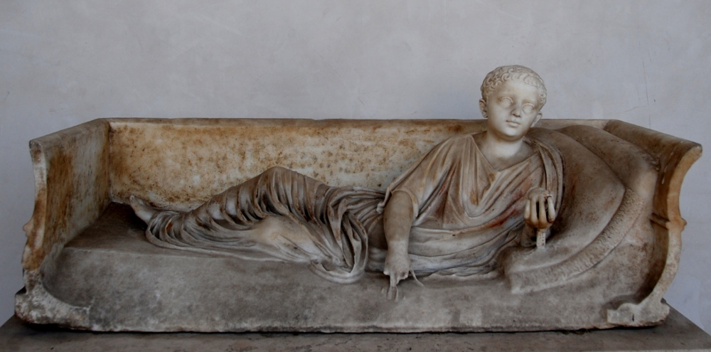 the lid of the sarcophagus of a youth